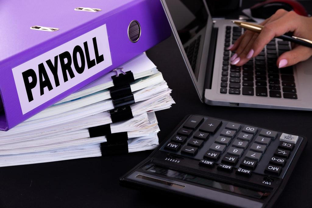 bigstock Text Word Payroll Is Written 365799841